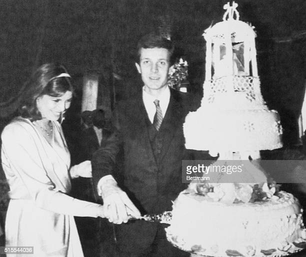 Princess Caroline of Monaco and her husband Stefano Casirahi cutting the wedding cake following the civil ceremony at the Palace of Monaco December 29