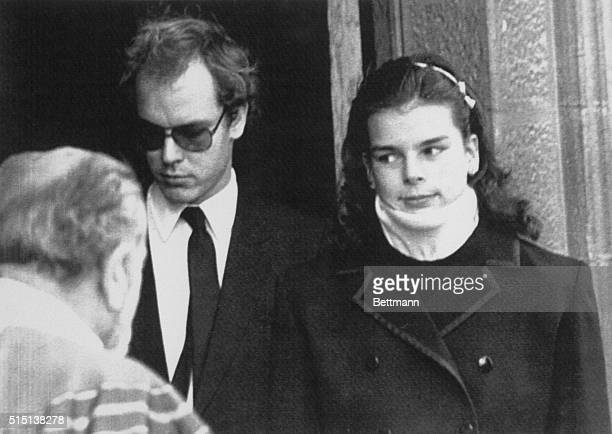 Princess Stephanie of Monaco wearing a neckbrace leaves the Monaco's Cathedral with her brother Prince Albert after attending a mass here October...