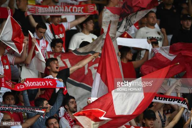 Monaco supporters cheer their team before the French L1 football match Monaco vs St Etienne on May 17 at the Louis II Stadium in Monaco. / AFP PHOTO...
