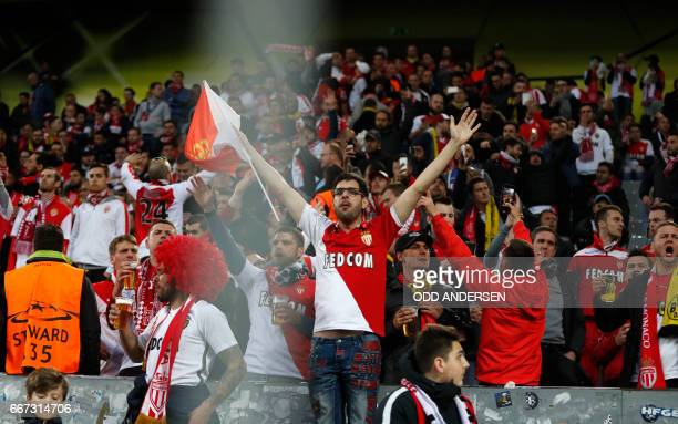 Monaco supporters react in the stadium after the match was postponed amid an explosion near the bus of Borussia Dortmund some 10km away from the...