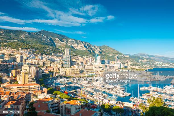 monaco view of la condamine and monte carlo - monte carlo stock pictures, royalty-free photos & images