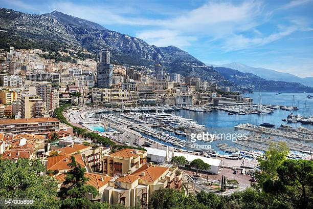 monaco, view of la condamine and monte carlo - monaco stock-fotos und bilder