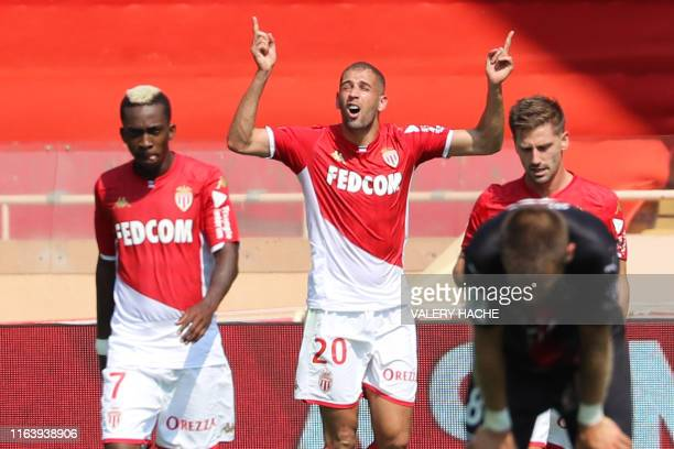 Monaco's Algerian forward Islam Slimani celebrates after scoring a goal during the French L1 football match between Monaco and Nimes on August 25,...