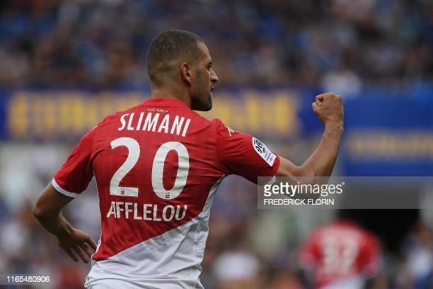 Monaco's Algerian forward Islam Slimani celebrates after scoring a goal during the French L1 football match between Strasbourg and Monaco on...
