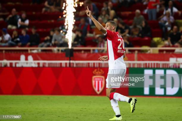 Monaco's Algerian forward Islam Slimani celebrates after scoring a goal during the French L1 football match between AS Monaco and Stade Brestois at...
