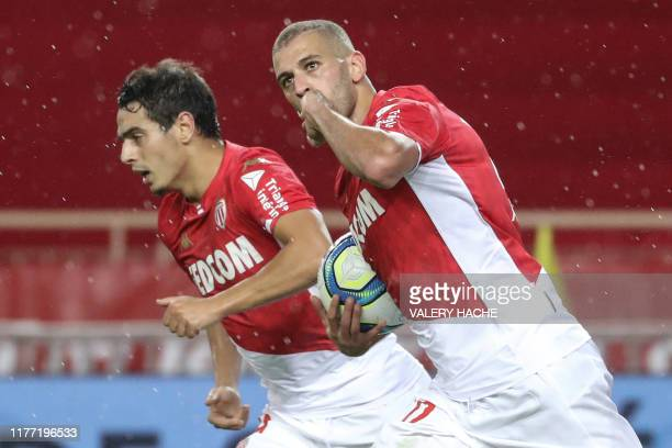 Monaco's Algerian forward Islam Slimani celebrates after scoring a goal during the French L1 football match Monaco vs Rennes on October 20, 2019 at...