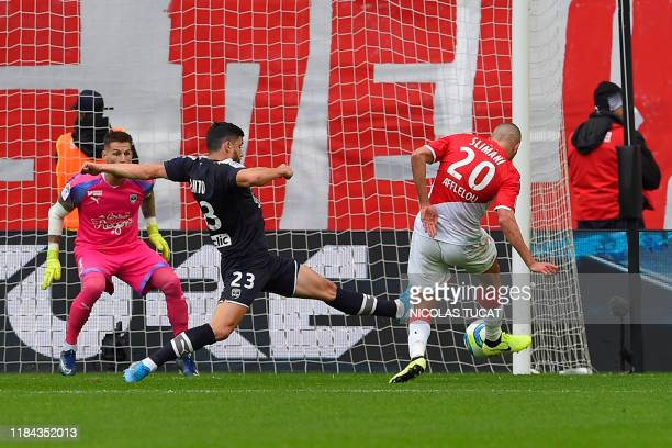 Monaco's Algerian forward Islam Slimani scores past Bordeaux's Swiss defender Loris Benito during the French L1 football match between FC Girondins...