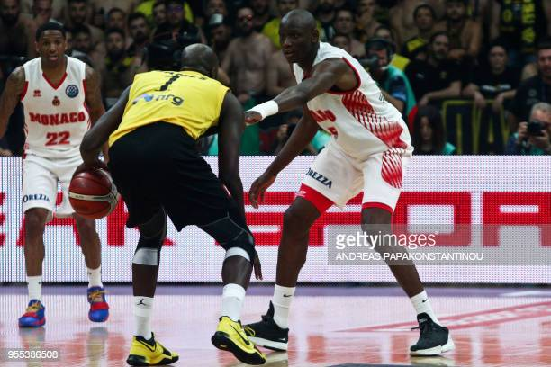 AS Monaco's Amara Sy vies with AEK Athens' Delroy James during the final four Champions League final basketball game between AS Monaco and AEK BC at...