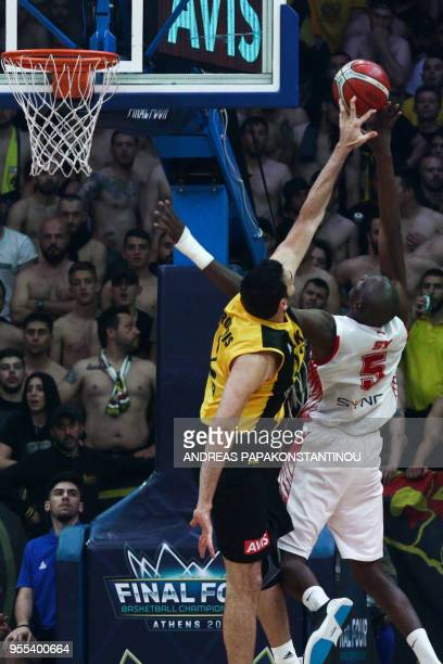 AS Monaco's Amara Sy vies with AEK Athen's Dimitris Mavroidis during the final four Champions League final basketball game between AS Monaco and AEK...