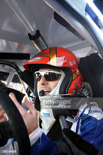 Monaco's anf former F1 driver Alex Caffi is pictured in his car during the centenary Monte Carlo rally on January 19 2011 at SaintBonnetleFroid...
