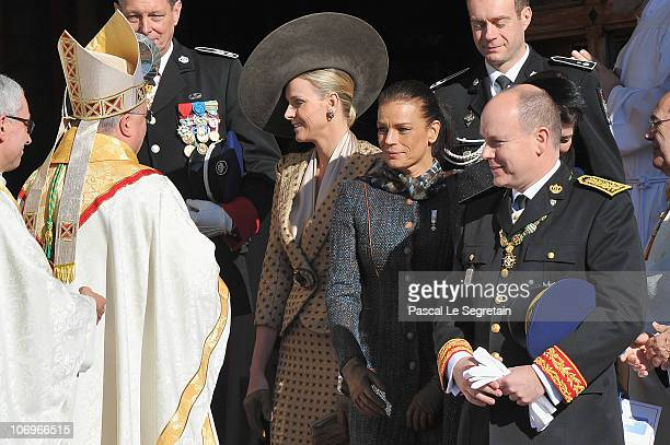 Monaco's Archbishop Bernard Barsi, Charlene Wittstock, princess Stephanie of Monaco and Prince Albert II of Monaco leave the Cathedral after they...