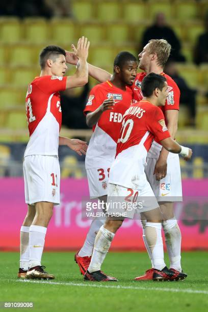 Monaco's Argentinian forward Guido Carrillo celebrates with his teammates after scoring during the French League Cup round of 16 football match...