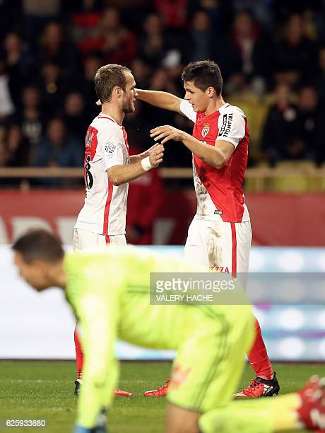 Monaco's Argentinian forward Guido Carrillo celebrates with Monaco's French forward Valere Germain after scoring a goal during the French L1 football...
