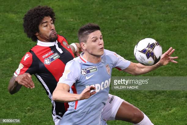 Monaco's Argentinian forward Guido Carrillo fights for the ball with Nice's Brazilian defender Dante during the French League Cup football match...