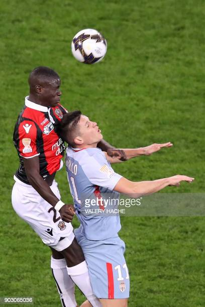 Monaco's Argentinian forward Guido Carrillo fights for the ball with Nice's French defender Malang Sarr during the French League Cup football match...