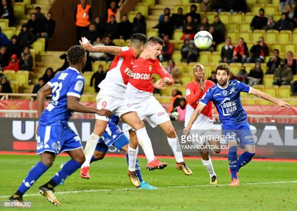 Monaco's Argentinian forward Guido Carrillo heads the ball and scores during the french L1 football match Monaco vs Troyes at The Louis II Stadium in...