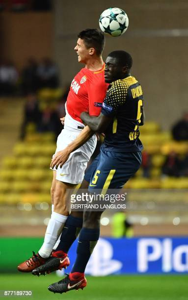 Monaco's Argentinian forward Guido Carrillo heads the ball with Leipzig's French defender Dayot Upamecano during the UEFA Champions League group G...