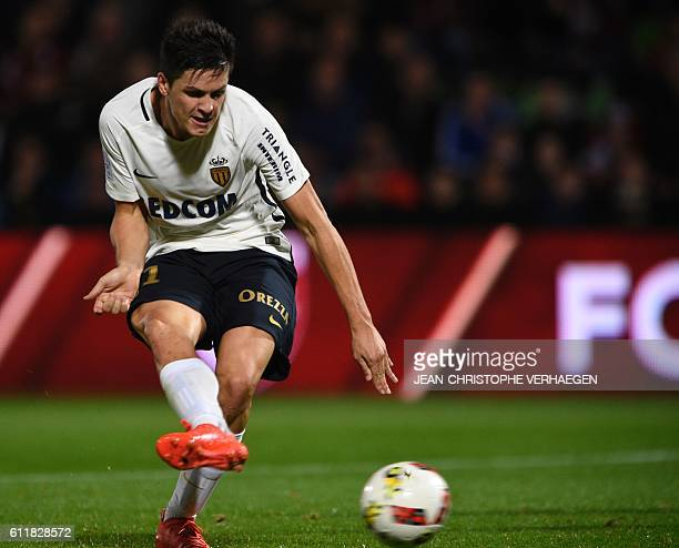 Monaco's Argentinian forward Guido Carrillo kicks the ball to score during the French L1 football match between Metz and Monaco on October 1, 2016 at...