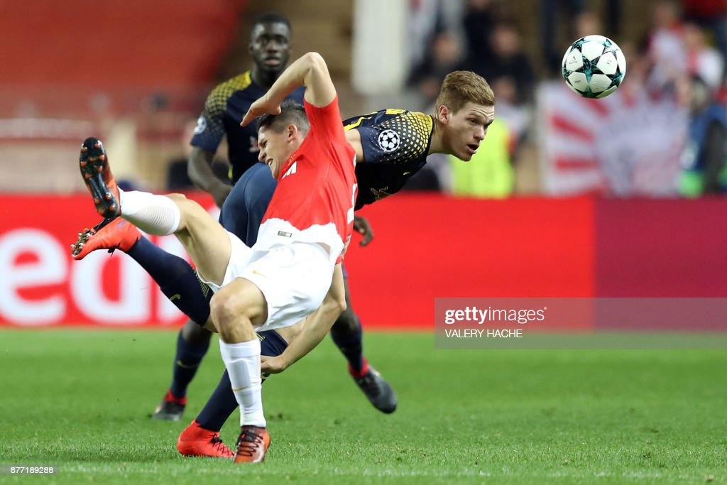 Monaco's Argentinian forward Guido Carrillo (front C) vies for the ball with Leipzig's German defender Marcel Halstenberg during the UEFA Champions League group G football match between Monaco and Leipzig at the Louis II stadium, in Monaco, on November 21, 2017. / AFP PHOTO / Valery HACHE
