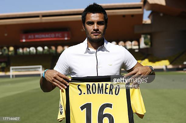 Monaco's Argentinian goalkeeper Sergio Romero presents his new jersey after a press conference at the Louis II stadium in Monaco on August 21 2013...