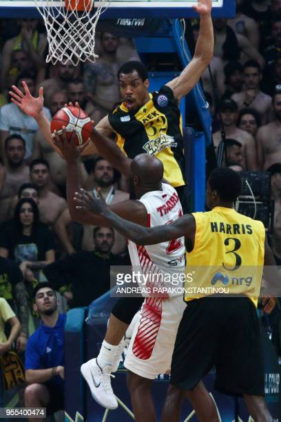 AS Monaco's Badara Ali Traore vies with AEK Athens Vince Hunter during the final four Champions League final basketball game between AS Monaco and...