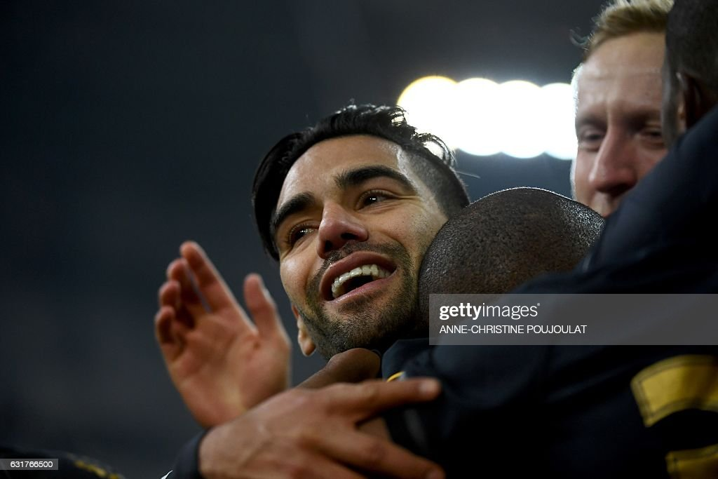 Monaco's Be Mota Veiga de Carvalho E Silva (hidden) is congratulated by Monaco's forward Falcao after scoring a goal during the French L1 football match Marseille vs Monaco on January 15, 2017 at the Velodrome stadium in Marseille, southern France. / AFP / ANNE
