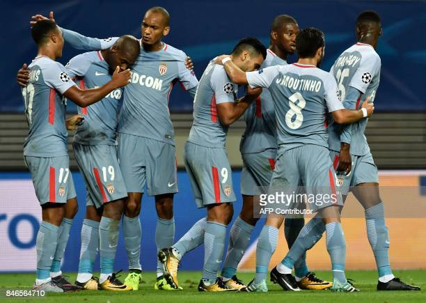 Monaco's Belgian midfielder Youri Tielemans celebrates scoring the 11 goal with his teammates during the UEFA Champions League group G football match...