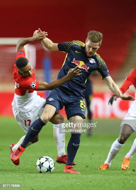 Monaco's Belgian midfielder Youri Tielemans vies for the ball with Leipzig's German defender Marcel Halstenberg during the UEFA Champions League...
