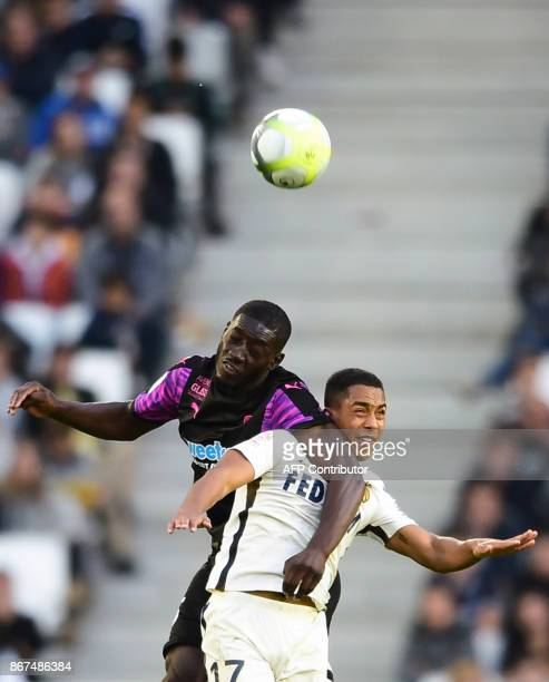 Monaco's Belgian midfielder Youri Tielemans vies with Bordeaux's French forward Alexandre Mendy during the French L1 football match between Bordeaux...