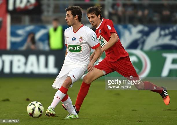 Monaco's Bernardo vies with Nîmes's Algerian defender Fethi Harek during the French Cup football match Nîmes vs Monaco on January 04 2015 at the...