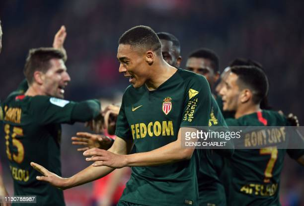 Monaco's Brasilian forward Carlos Vinicius celebrates after scoring a goal during the French L1 football match between Lille OSC and Monaco at the...