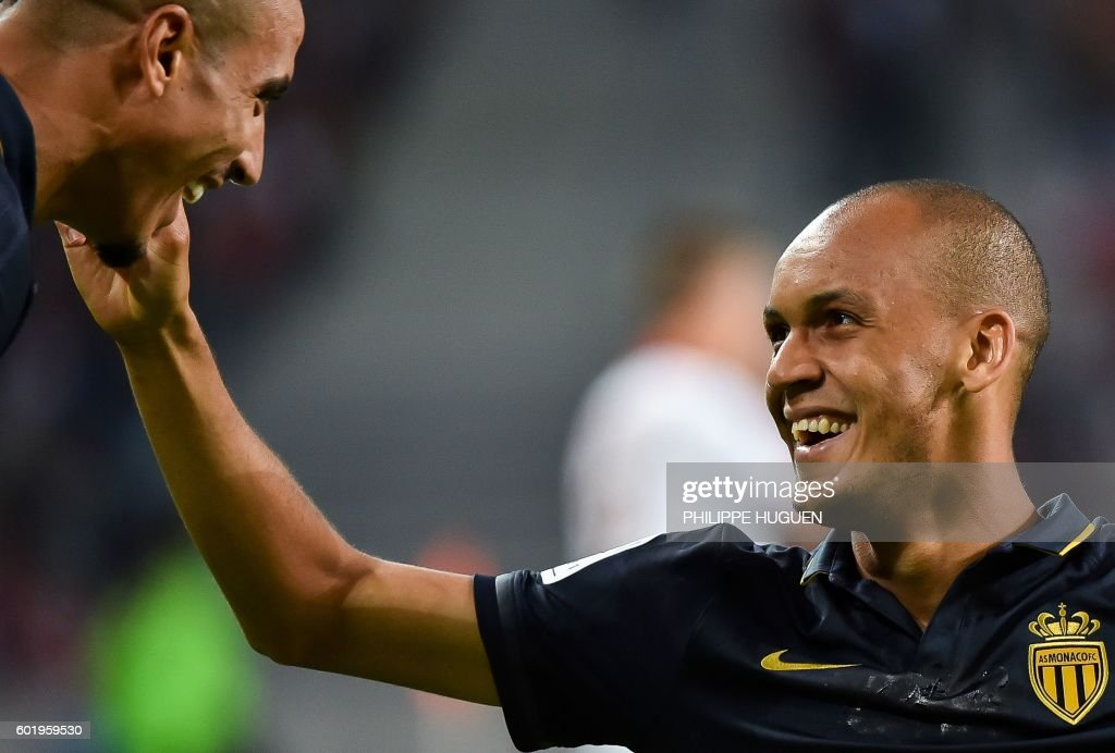 Monaco's Brazilian defender Fabinho (R) celebrates after scoring a goal with Monaco's Moroccan midfielder Nabil Dirar during the French L1 football match between Lille OSC (LOSC) and AS Monaco FC (ASMFC) at the Pierre-Mauroy Stadium in Villeneuve d'Ascq, near Lille, northern France, on September 10, 2016. / AFP / PHILIPPE