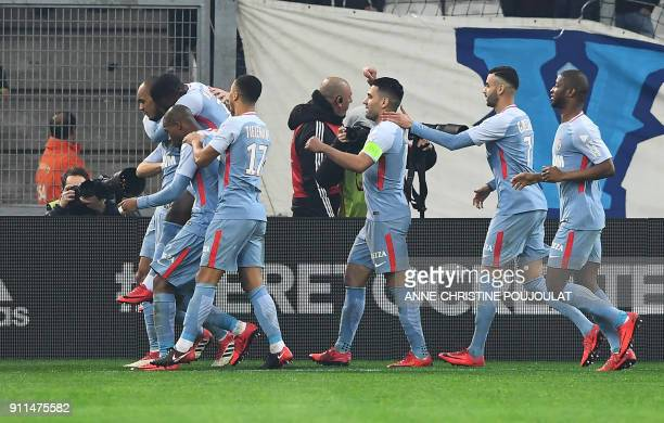 Monaco's Brazilian defender Fabinho celebrates with teammates after scoring a goal during the French L1 football match Marseille vs Monaco on January...