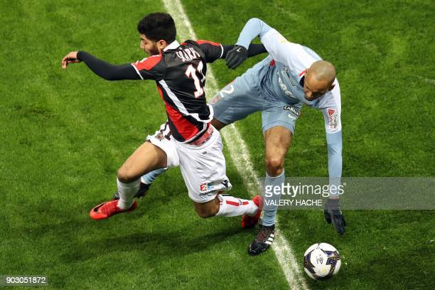 Monaco's Brazilian defender Fabinho fights for the ball with Nice's Tunisian forward Bassem Srarfi during the French League Cup football match...