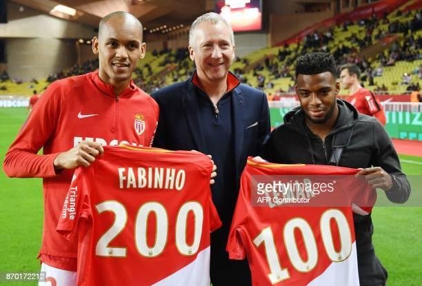 Monaco's Brazilian defender Fabinho Monaco's Russian Vice club President Vadim Vasilyev Monaco's French midfielder Thomas Lemar pose vith jersey...