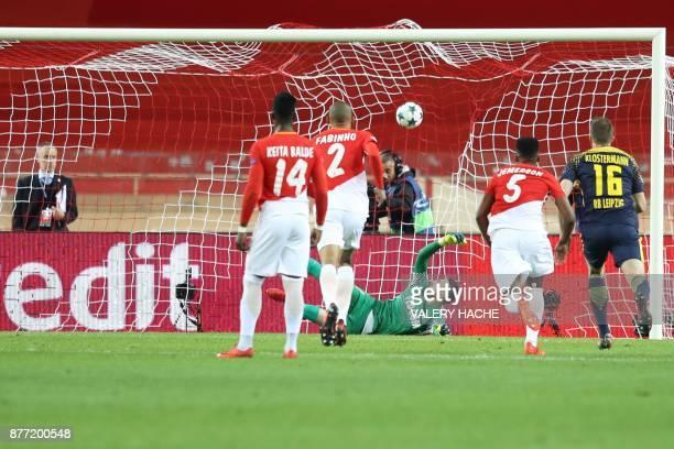 Monaco's Brazilian defender Jemerson scores a goal against his own team during the UEFA Champions League group G football match between Monaco and...