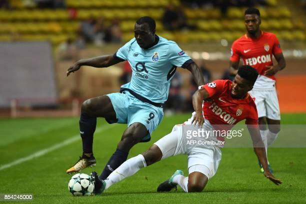 Monaco's Brazilian defender Jemerson tackles Porto's Cameroonian forward Aboubakar during the UEFA Champions League Group G football match AS Monaco...