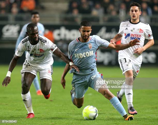Monaco's Brazilian defender Jorge outruns Amiens' Senegalese forward Pape Moussa Konate during the French L1 Football match Amiens vs Monaco on...