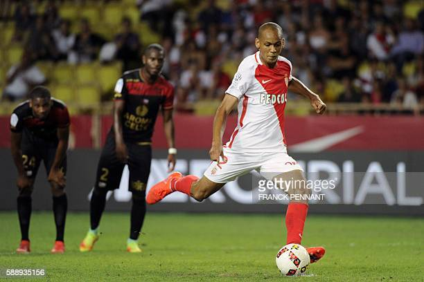 Monacos Brazilian midfielder Fabinho scores a penalty goal during the French L1 football match between Monaco and Guingamp on August 12 at the Louis...