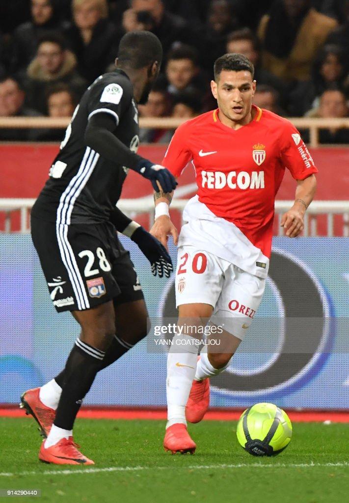 Monaco's Brazilian midfielder Rony Lopes (R) vies with Lyon's French midfielder Tanguy Ndombele during the French L1 football match Monaco (ASM) vs Lyon (OL) on February 4, 2018 at Louis II stadium in Monaco. /