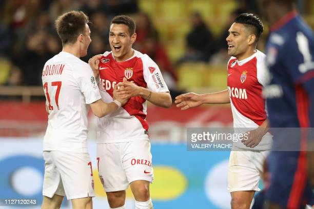Monaco's Brazilian midfielder Rony Lopez celebrates with Monaco's Colombian forward Radamel Falcao and Monaco's Russian midfielder Aleksandr Golovin...