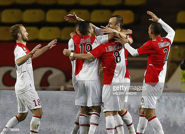 Monaco's Bulgarian forward Dimitar Berbatov celebrates with teammates after scoring a goal during the French L1 football match between AS Monaco and...