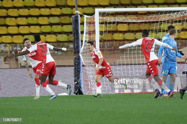 """Monaco's Chilean defender Guillermo Maripan celebrates after scoring a goal during the French L1 football match Monaco and Marseille at """"Louis II""""..."""
