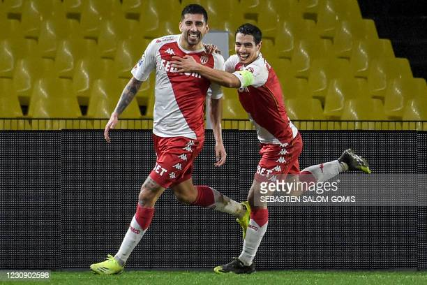 Monaco's Chilean defender Guillermo Maripan celebrates with Monaco's French forward Wissam Ben Yedder after scoring a goal during the French L1...