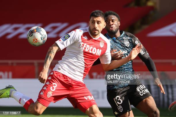 Monaco's Chilean defender Guillermo Maripan fights for the ball with Lorient's Nigerian forward Terem Moffi during the French L1 football match...