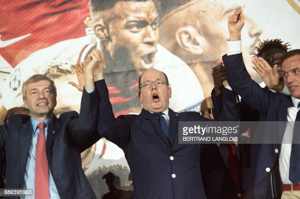 Monaco's club's Russian president Dmitriy Rybolovlev and Prince Albert II of Monaco acknowledge their fans on May 21, 2017 in Monaco, during a...