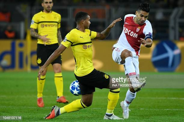 Monaco's Colombian forward Falcao and Dortmund's Swiss defender Manuel Akanji vie for the ball during the UEFA Champions League Group A football...