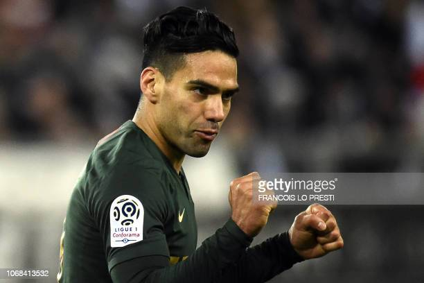 Monaco's Colombian forward Falcao celebrates after scoring during the French L1 football match between Amiens SC and AS Monaco at the Licorne stadium...