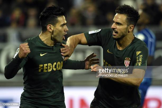 Monaco's Colombian forward Falcao celebrates with Monaco's Belgian midfielder Nacer Chadli after scoring during the French L1 football match between...