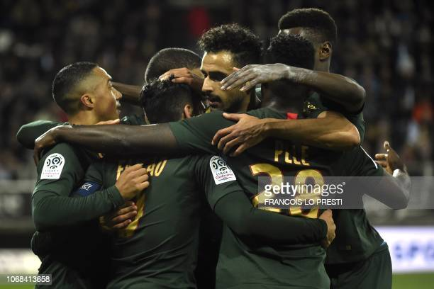 Monaco's Colombian forward Falcao celebrates with teammates after scoring during the French L1 football match between Amiens SC and AS Monaco at the...